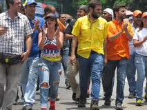 Opposition lawmaker Juan Requesens, yellow, is escorted by his colleague stock image