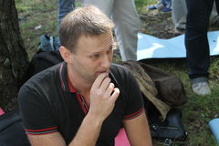 Opposition leader Alexei Navalny listens to speeches at the meeting of activists in Khimki forest. Stock Photo