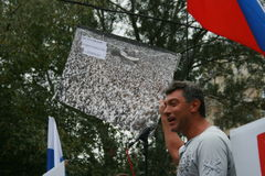 Opposition leader Boris Nemtsov holds an old photo with thousands of opposition rally and the rally on the anniversary of the even. Moscow, Russia - August 22 stock photography