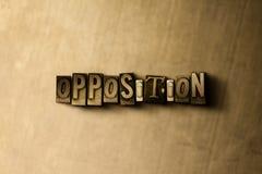 OPPOSITION - närbild av det typsatta ordet för grungy tappning på metallbakgrunden royaltyfri bild