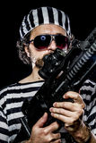Opposition, Prison riot concept. Man holding a machine gun, pris Royalty Free Stock Photo