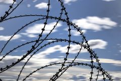 Oppressive Razor Wire. Used to entangle people from getting through or over a barrier Royalty Free Stock Photos