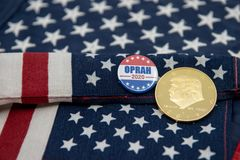 Oprah 2020 presidential badge and Donald Trump coin stock photo