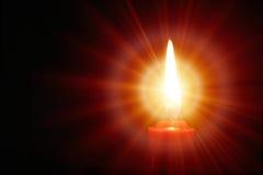 Opromieniona świeczka Fotografia Stock