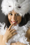 Ops sorry. Nice brunette with white feather mask and red lips making face Royalty Free Stock Image