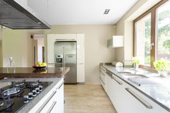 Opt for functionality. Shot of a white spacious kitchen in a modern house Stock Photography