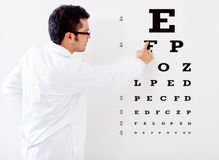Optemetrist making a vision test Stock Images