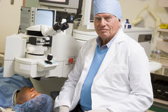 Opthamologist Performing Laser Eye Treatment Stock Images
