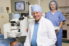 Opthamologist Performing Laser Eye Treatment Royalty Free Stock Photography