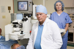 Opthamologist Performing Laser Eye Treatment Stock Photo