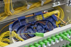 Optic fiber cable and splicing the fibers on spice tray royalty free stock photos