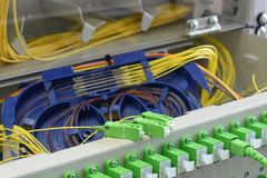 Optic fiber cable and splicing the fibers on spice tray stock photos