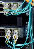 Optic fiber cables connected to a switch Stock Photo