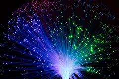 Optic fiber lamp. Illuminated colorful optic fiber lamp on black background stock photography