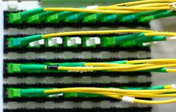 Optic fibes connected to cross Stock Images