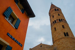 Small italian town view of shop and tower bell with cloudy sky royalty free stock images