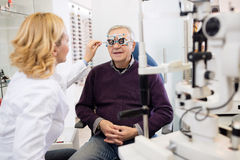 Optic specialists views eyesight to patient Stock Photography