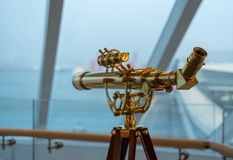Optical brass telescope on deck of cruise ship royalty free stock images