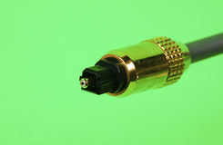 Optical Cable. Photo of Optical Audio Cable on Green Background Royalty Free Stock Photo