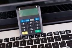 Optical chip TAN Generator and laptop Stock Image