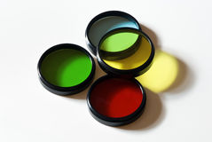 Optical color filters. Old glass color filters isolated changing colors royalty free stock image