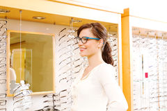 Optical customer pleased with glasses. Customer in optometry office please with new glasses Stock Image