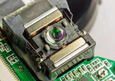 Optical device. The optical pick-up unit.It can emitting light and accurately focusing for reading information Royalty Free Stock Photo