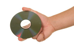 Optical disk in hand. On white background Stock Photos