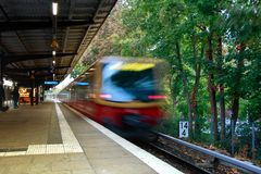 Optical distortion of a departing train in berlin royalty free stock photos