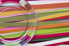 Optical distortion of smooth multicolored strips. Abstract background. Strips of colored paper. Multicolored stripes. Distortion of lines through glass. Bright Stock Photography