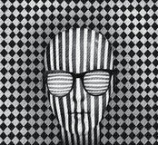 Optical effect. Graphic illustration with optical effect representing a person's head covered with vertical stripes with glasses horizontal stripes and white Royalty Free Stock Photos