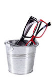 Optical eyeglasses in a bucket Stock Images