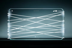 Optical fiber emitting white light with transparent smartphone Royalty Free Stock Images