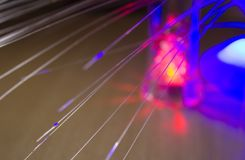 Optical fiber, light - emitting diodes close up. Bright glowing multicolored blurred background with a bokeh royalty free stock images