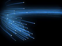 Optical fibres. Bunch of the blue optical fibres dinamic flying from deep on black background stock illustration