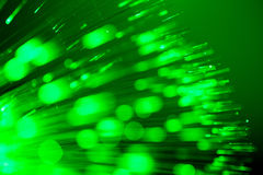 Optical fibres abstract blurred technology background. Bunch of optical fibres flying from deep as blurred abstract technology background Stock Images