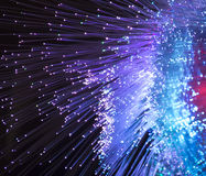 Optical fibres dinamic flying from deep Royalty Free Stock Photos