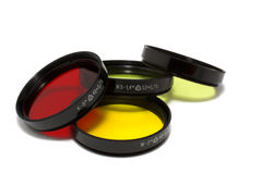 Optical filters. Glass optical filters red, yellow and yellow-green isolation on the white Royalty Free Stock Photos
