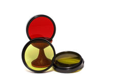 Optical filters. Glass optical filters red, yellow and yellow-green isolation on the white Stock Images