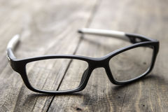 Optical glasses on wooden background Stock Image