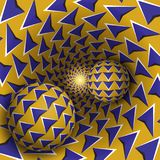 Optical illusion illustration. Two balls with arrows pattern are moving on rotating blue arrows yellow funnel. Abstract fantasy in a surreal style Stock Photos