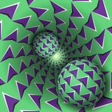 Optical illusion illustration. Two balls with arrows pattern   Stock Photography