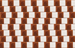Optical illusion with lumps of white/cane sugar Royalty Free Stock Images