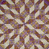 Optical Illusion Needlepoint Detail. Close up of a needlepoint pillow stitched by Cathy Decker in yellow and purple pearl cotton thread. Geometric patterns such Stock Photography