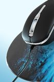 Optical Infrared mouse on pad Royalty Free Stock Photos