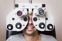 Optical lab. Young boy in an optical scans machine exams his vision and optometry Stock Photos
