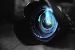 Optical Lens lies on the table. Photo, reflections Stock Photos