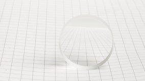 Optical lens on the school notebook Stock Images