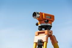 Optical level on tripod over blue sky Stock Image