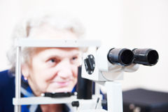 Optical medical devices for eyesight examination. Optical medical devices used for eyesight examination of senior woman. Shallow DOF Stock Images